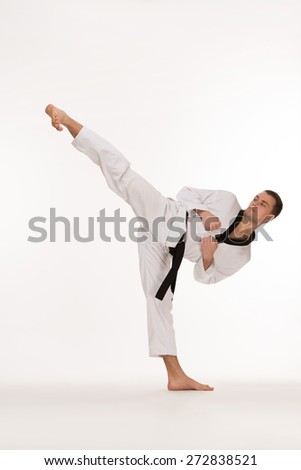 Fighter show foot kick on white background - stock photo