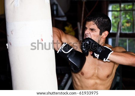 Fighter training in garage. - stock photo