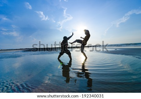Fighting an enemy near the beach when the sun rising up - stock photo