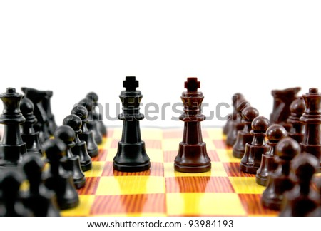 fighting between of the leader on chess board - stock photo