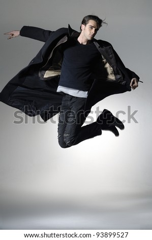 Fighting businessman kicked in the jump, isolated on a light background