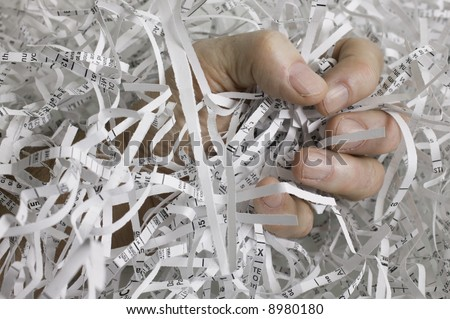 Fighting identity theft by shredding sensitive documents. Also shows frustration of the thief. - stock photo
