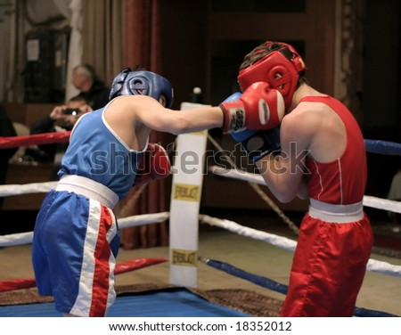 fighting on boxing ring