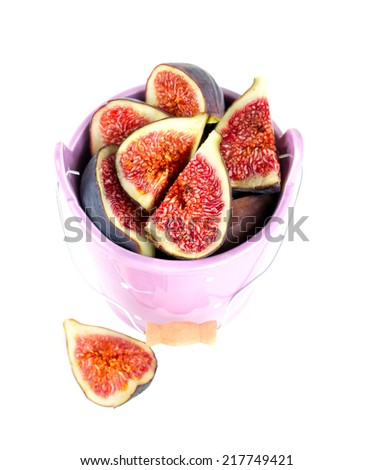 figs in bucket isolated on white - stock photo