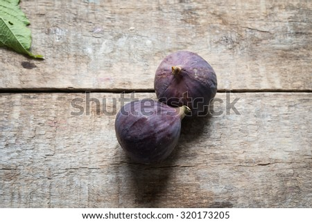 Figs on a wooden background - stock photo
