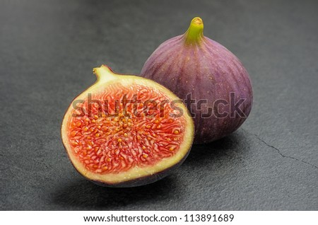 figs on slate plate - stock photo
