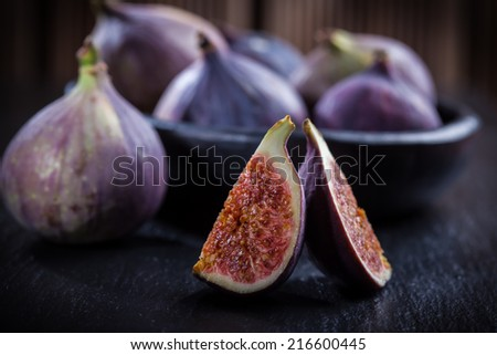 Figs on wooden table - stock photo