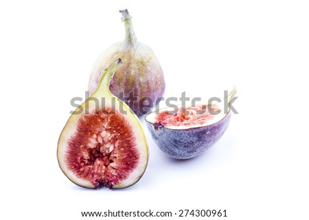 Figs whole and halved shot on white background scattered - stock photo
