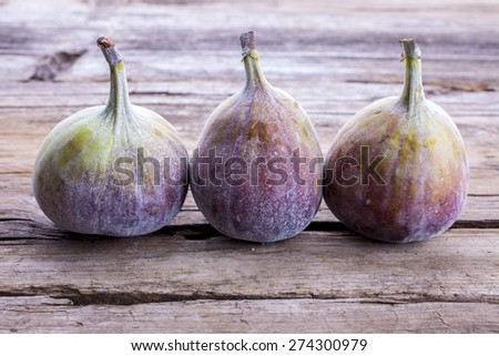 Figs whole shot on wood front on - stock photo
