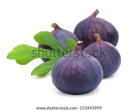 Figs with green leaves. - stock photo
