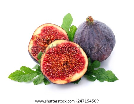 Figs with leaves on the white background.  - stock photo