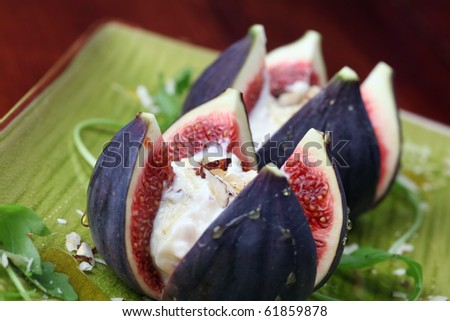 Figs with nut and honey cheese. Shallow dof - stock photo