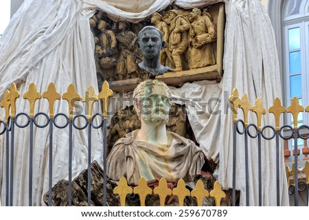Figueres, Spain - June 17, 2014: Monument to Francesc Pujols at entrance to Dali's Theatre - Museum building, opened on September 28, 1974 and housing largest collection of works by Salvador Dali. - stock photo