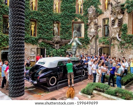 FIGUERES, SPAIN - SEPTEMBER 8, 2010: Unidentified people at Dali's Museum in Figueres, Spain. Salvador Dali is buried in a crypt in the Museum basement. - stock photo