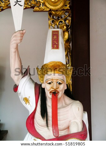 figure in Peranaken temple in Singapore