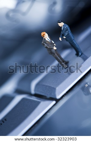 Figure man over computer background - stock photo