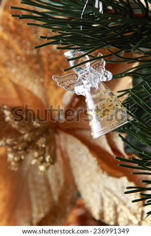 Figure of an angel decorating a Christmas tree