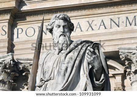 Figure of apostle Pavel against a front wall of St. Peter's Cathedral, Vatican - stock photo