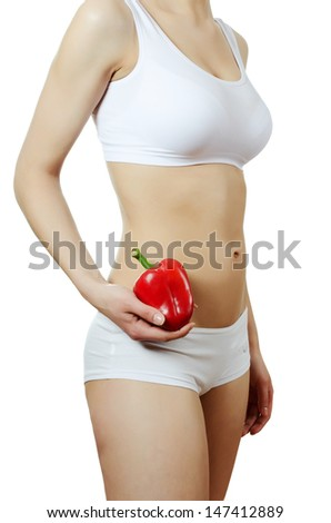 Figure of girl with pepper in hand - stock photo