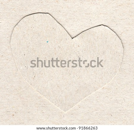 Figure of heart is cut out of cardboard - stock photo