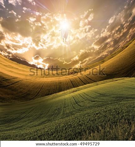 Figure of Light Appears in Sky over Beautiful Landscape - stock photo