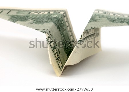 Figure of plane from dollars - stock photo