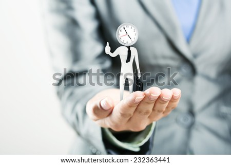 Figure of punctual businessman on palm - stock photo