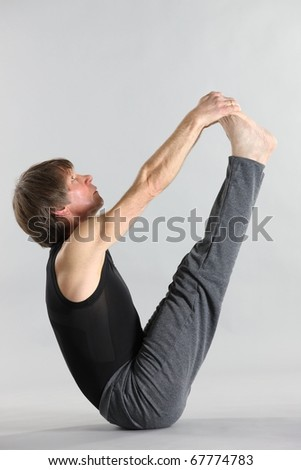 Figure of the young man in sportswear on a grey background - stock photo