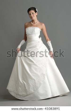 Figure of the young woman in a white dress - stock photo