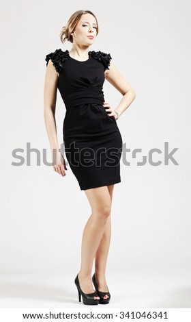 Figure of young woman in black dress