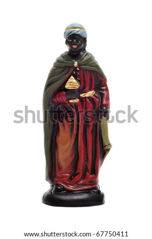 figure representing Balthasar Magi in a nativity scene on white background - stock photo