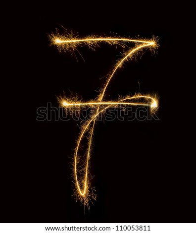 Figure seven.abstract sparkler figures on black background.. - stock photo
