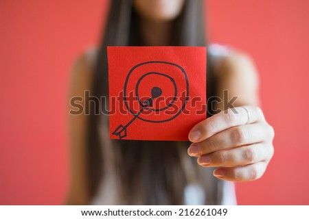Figure target icon in the hand - stock photo