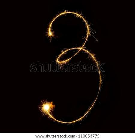 Figure three.abstract sparkler figures on black background. - stock photo