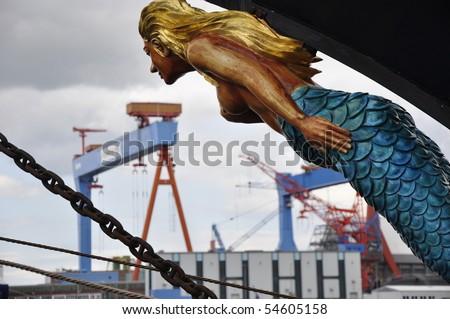 figurehead look into the harbor of Kiel, Germany, with its wharf - stock photo