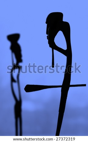 Figures Africans on a blue background - stock photo