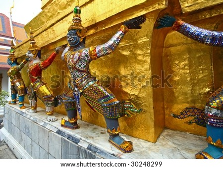 figures in grand palace bangkok - stock photo