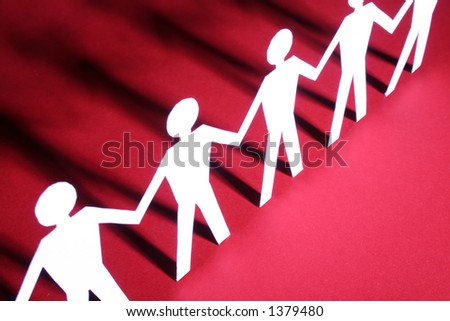 figures of man in paper on red - stock photo