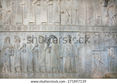 Figures of people on the destroyed stone bas-relief in famous city Persepolis, Fars Province, Iran. Persepolis was a capital of the Achaemenid Empire (550 - 330 BC).  - stock photo