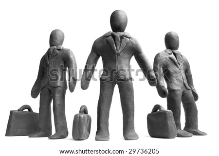 Figures of  plasticine businessmen on a white background