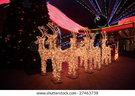 Figures of shone deer with sledge - stock photo