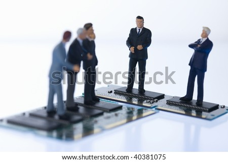 Figures of the businessman who communicates on the computer chip.