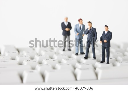 Figures of the businessman who lines up on the keyboard.