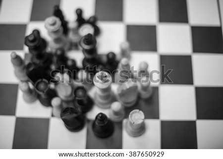 Figures on a chess board - stock photo