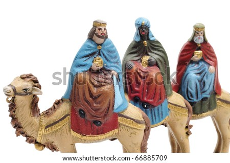 figures representing the three kings in a nativity scene on white background - stock photo