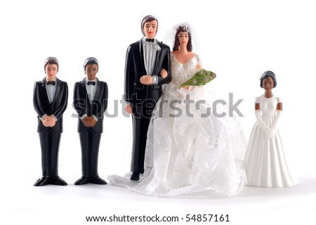 Figurine bride and groom with family - stock photo