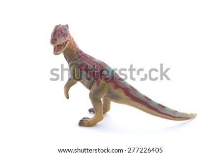 Figurine dinosaur on white - stock photo