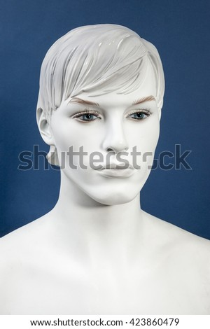 Figurine Head, monochrome on the blue background - stock photo