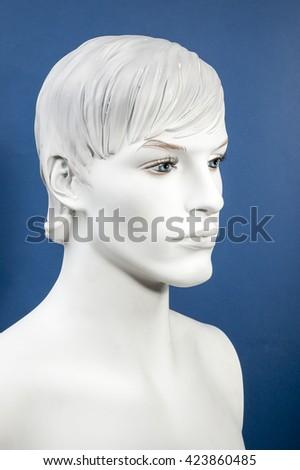Figurine Head, monochrome on the blue background - stock photo