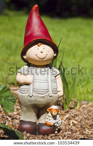 figurine-jardin-nains-berger-garden gnome-statue - stock photo